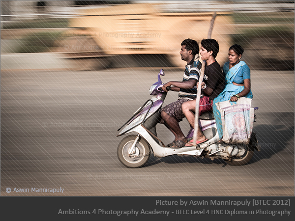 Family with luggage on a scooter