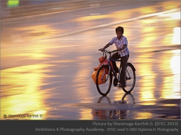 Boy with plastic pots of water on his bicycle